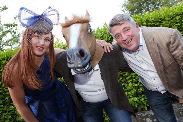 Photograph of Martin Shanahan, Fishy Fishy Restaurant, with female model and man wearing horse's head