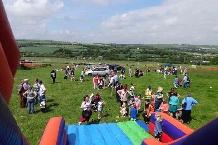 Photograph of inflatable slide and children at Kinsale races