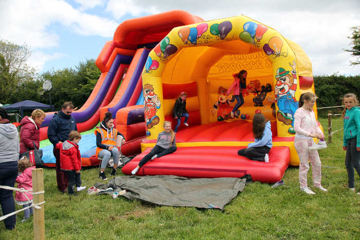 Photograph of Bouncy Castle and Inflatable slide with children playing