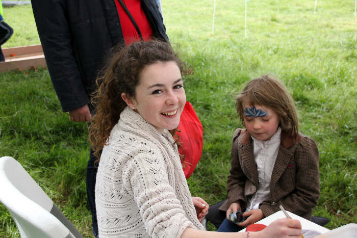 Photograph of small girl getting her face painted