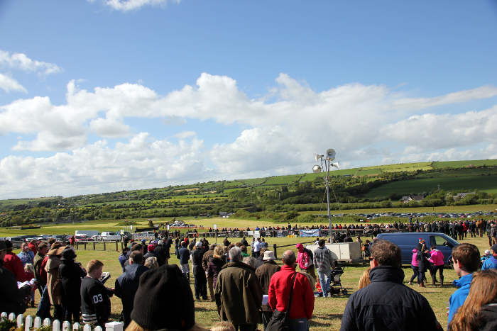 Photograph of crowds watching race at Kinsale Point to Point