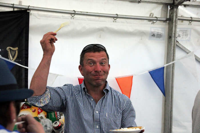 Photograph of man enjoying food at Kinsale Point to Point