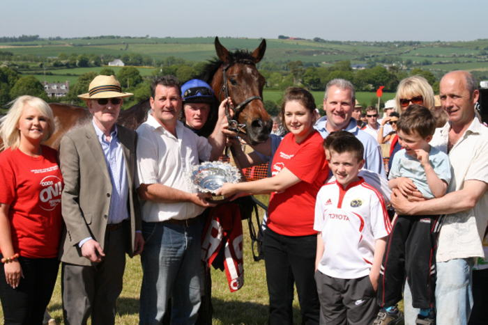 Owners receiving presentation of silver plate for winning race at Kinsale Point to Point