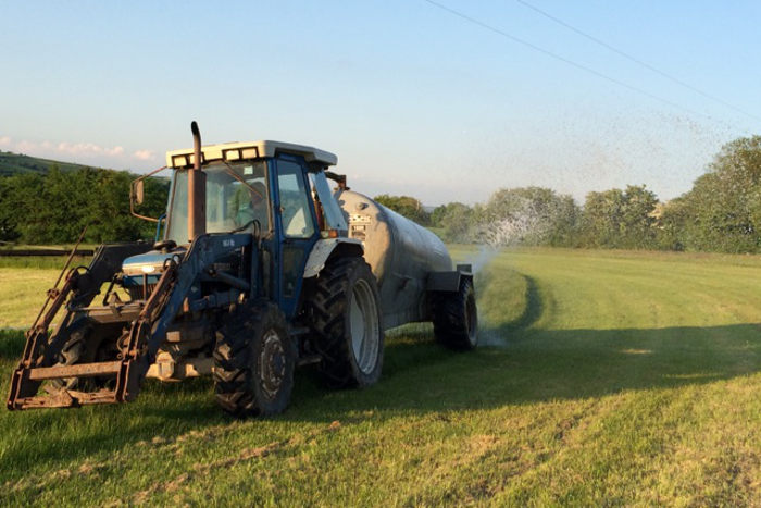 Tractor watering the course at Kinsale Point to Point racetrack